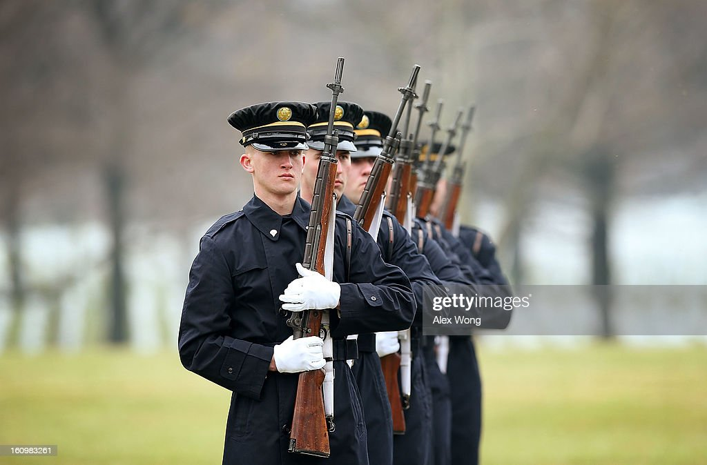 A firing party participates during the funeral of Army Sergeant Aaron X. Wittman February 8, 2013 at Arlington National Cemetery in Arlington, Virginia. Sergeant Wittman, 28, of Chester, Virginia, was assigned to 3rd Battalion, 69th Armor Regiment, 1st Brigade Combat Team, 3rd Infantry Division in Fort Stewart, Georgia. He died on January 10, 2013 in Khogyani District of Nangarhar Province in Afghanistan, from injuries sustained after his unit was hit by a small arms fire.