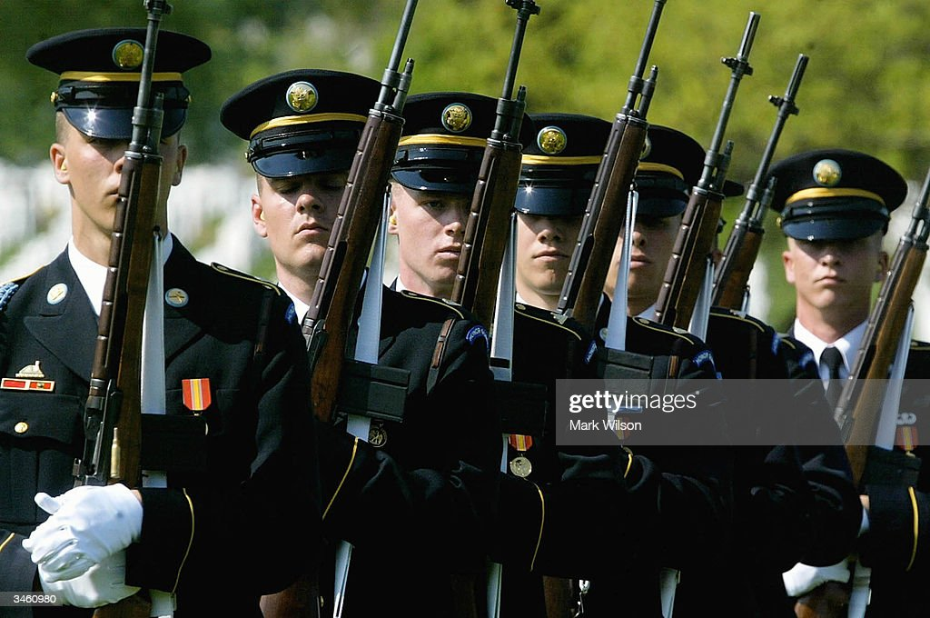 A firing party prepare to deliver a 21 gun salute during a funeral for US Army Sgt. Yihiyh Chen at Arlington National Cemetery April 23, 2004 in Arlington, Virginia. Chen was killed on April 4th in Baghdad, Iraq when his unit was attacked with rocket propelled grenades and small arms fire.