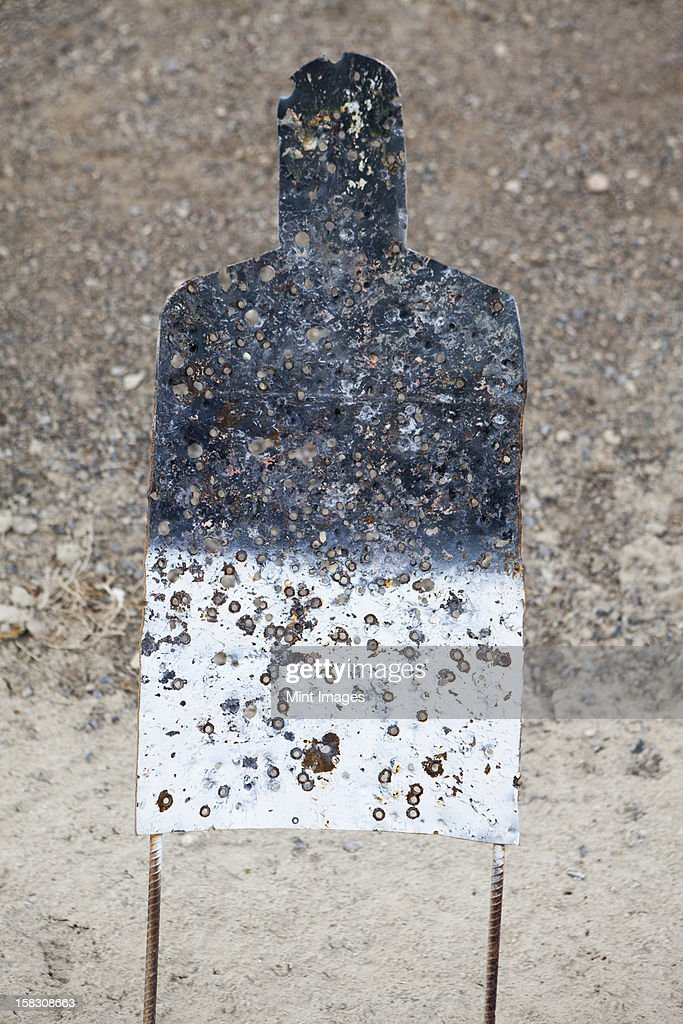 A firing practice target in the shape of a person,  on a desert firing range in Nevada. : Stock Photo