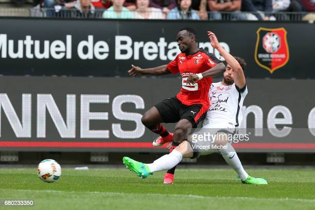 Firmin Mubele of Rennes and Mathieu Deplagne of Montpellier during the Ligue 1 match between Stade Rennais and Montpellier Herault at Roazhon Park on...