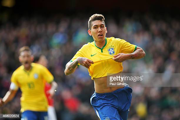 Firmino of Brazil celebrates after scoring the opening goal during the international friendly match between Brazil and Chile at the Emirates Stadium...