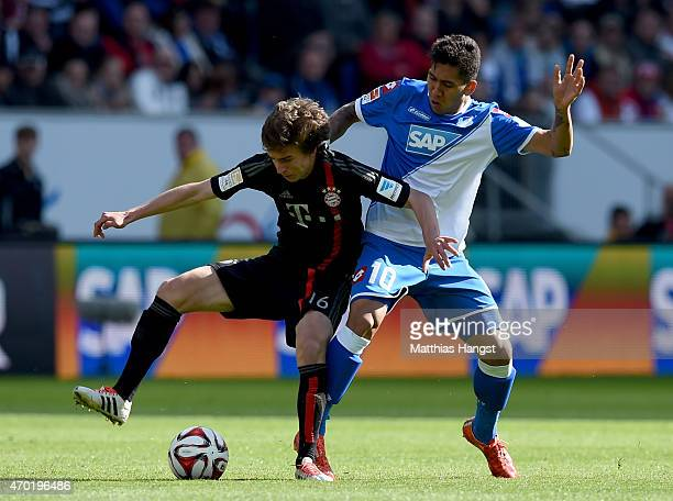 Firmino of Hoffenheim battles for the ball with Gianluca Gaudino of Muenchen during the Bundesliga match between 1899 Hoffenheim and FC Bayern...