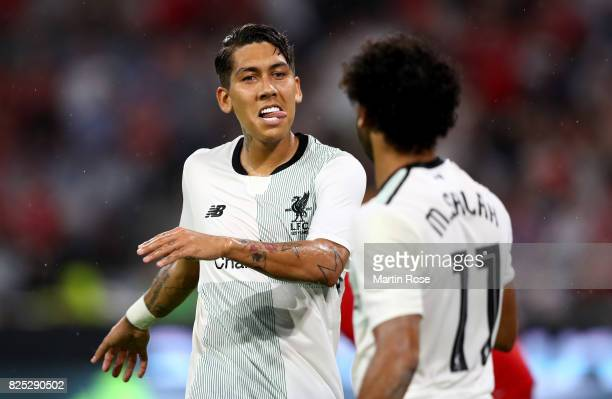 Firmino of Liverpool celebrate with team mate Mohamed Salah the 2nd goal during the Audi Cup 2017 match between Bayern Muenchen and Liverpool FC at...
