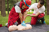 CPR or cardiopulmonary resuscitation. Young educators demonstrating first aid lifesaving technique