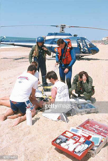 First aid Emergency medical service on the beach with helicopter
