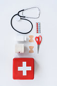 flat lay with medical and first aid kit objects, isolated on white