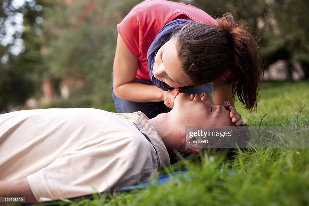 First aid - Look, listen and feel for breathing. : Stock Photo