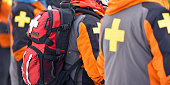 First aid ski patrol with backpacks and gear. Alberta, Canada.