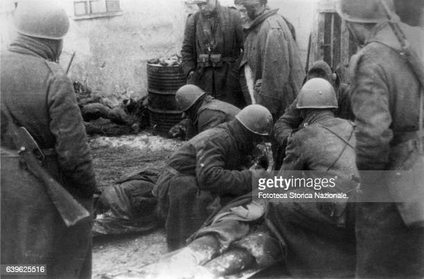 "First aid to the companions exhausted and frozen of the battalion ""L' Aquila"" during the disastrous retreat Photo by Gianfranco Ucelli veteran..."
