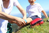 Child twisted his ankle during a mountain tour. Wound broken leg.