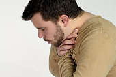 first aid - young man choking over a white background