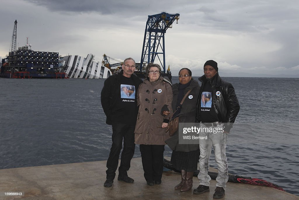 First anniversary of the sinking of the cruise ship Costa Concordia in Italy off the island of Giglio (32 victims) , parents of victims before a commemorative plaque, Brigitte Litzler mother of Mylene, 23 years and Chislene Blemand mother of Mickael 25 years two lovers dead together in the sinking, Giglio Island in January 13, 2013.