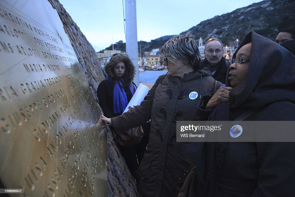 First anniversary of the sinking of the cruise ship Costa Concordia in Italy off the island of Giglio (32 victims) , parents of victims before a commemorative plaque, Brigitte Litzler mother of Mylene, 23 years and Chislene Blemand mother of Mickael 25 years two lovers died together in the sinking, Giglio Island in January 13, 2013.