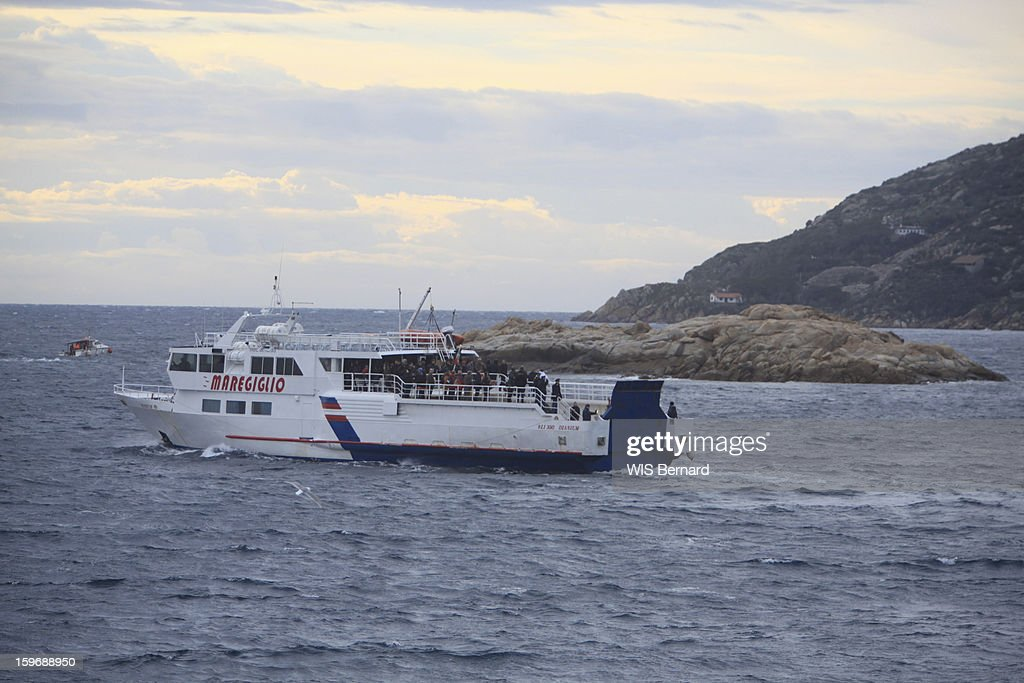 First anniversary of the sinking of the cruise ship Costa Concordia in Italy off the island of Giglio (32 victims) , a ferry takes the victims' families near the wreck in January 13, 2013.