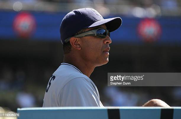 First base coach Dave Roberts of the San Diego Padres watches the game with the Los Angeles Dodgers from the dugout on July 9 2011 at Dodger Stadium...