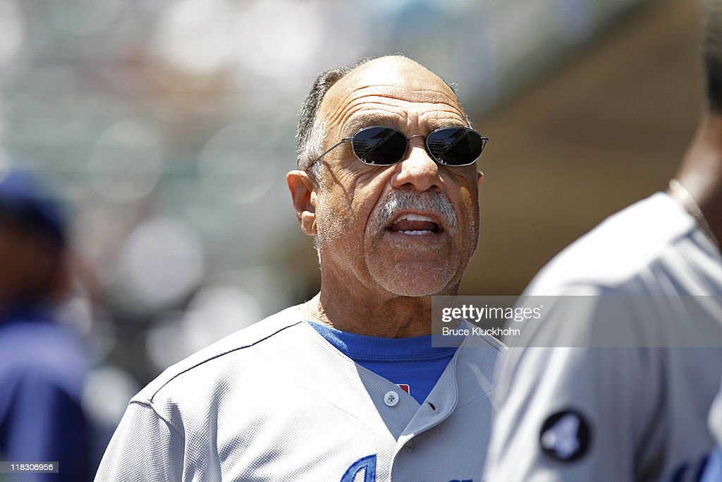 First base coach <a gi-track='captionPersonalityLinkClicked' href=/galleries/search?phrase=Davey+Lopes&family=editorial&specificpeople=213048 ng-click='$event.stopPropagation()'>Davey Lopes</a> talks with a player in the dugout during the game against the Minnesota Twins on June 29, 2011 at Target Field in Minneapolis, Minnesota. The Twins won 1-0.