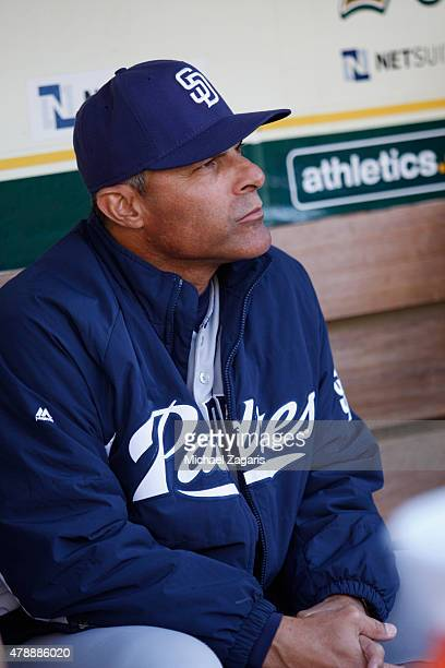 First Base Coach Jose Valentin of the San Diego Padres sits in the dugout prior to the game against the Oakland Athletics at Oco Coliseum on June 17...