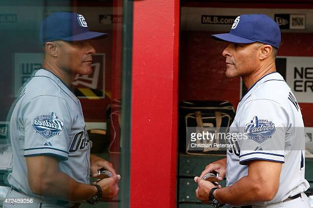 First base coach Jose Valentin of the San Diego Padres walks through the dugout before the MLB game against the Arizona Diamondbacks at Chase Field...