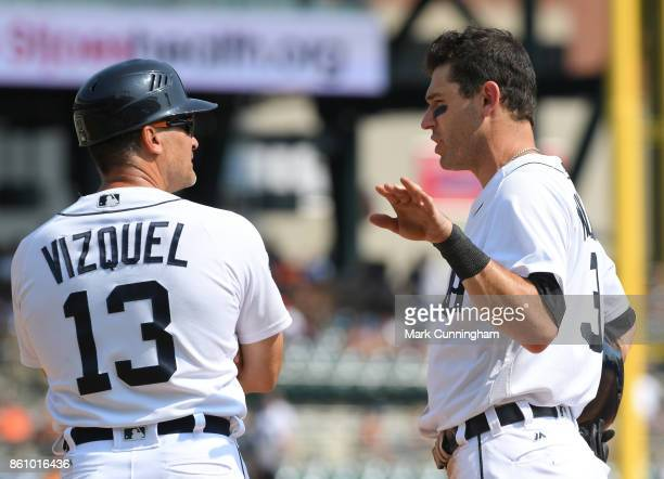 First base coach Omar Vizquel and Ian Kinsler of the Detroit Tigers talk together on the field during the game against the Chicago White Sox at...