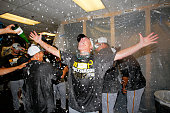 First base coach Rick Sofield of the Pittsburgh Pirates celebrates clinching a National League playoff spot after their 32 win over the Atlanta...