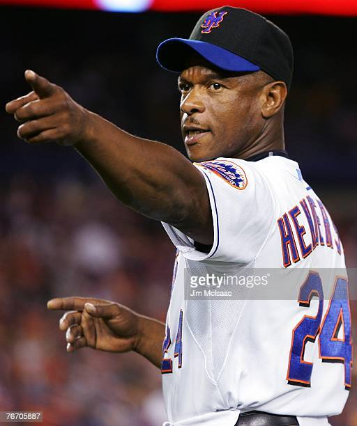 First base coach Ricky Henderson of the New York Mets points to the crowd during their game against the Atlanta Braves on September 12 2007 at Shea...
