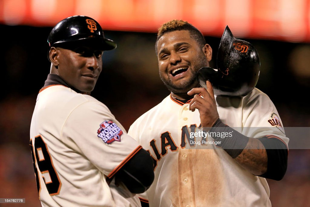 First base coach Roberto Kelly #39 and Pablo Sandoval #48 of the San Francisco Giants look on against the Detroit Tigers during Game Two of the Major League Baseball World Series at AT&T Park on October 25, 2012 in San Francisco, California.