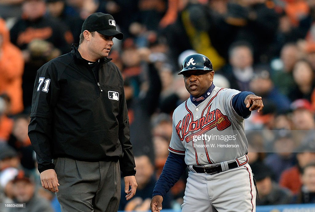 First Base coach Terry Pendleton #9 of the Atlanta Braves argues with first base umpire Jordan Baker #71 over an out call on Brian McCann #16 (not pictured) at first base against the San Francisco Giants in the second inning at AT&T Park on May 10, 2013 in San Francisco, California.