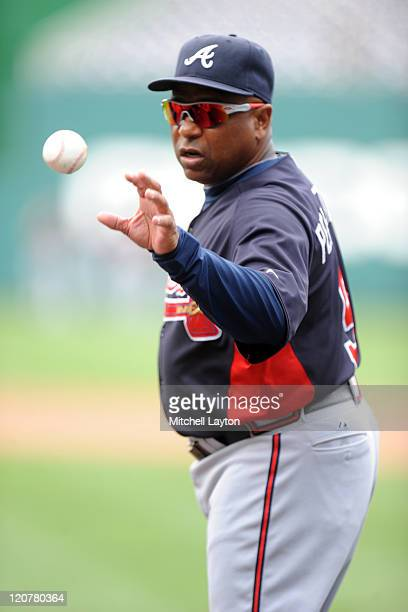 First base coach Terry Pendleton of the Atlanta Braves looks on before a baseball game against the Washington Nationals at Nationals Park on August 1...
