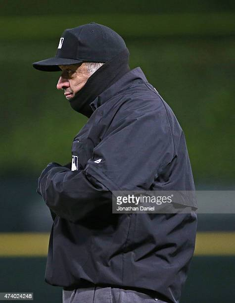 First base umpire Dale Scott is bundled up for cold weather as the Chicago White Sox take on the Cleveland Indians at US Cellular Field on May 19...