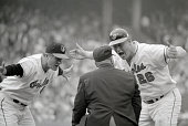 First base umpire Emmett Ashford gets an earful from Orioles skipper Earl Weaver and base runner Boog Powell during Game 5 of the 1970 World Series...