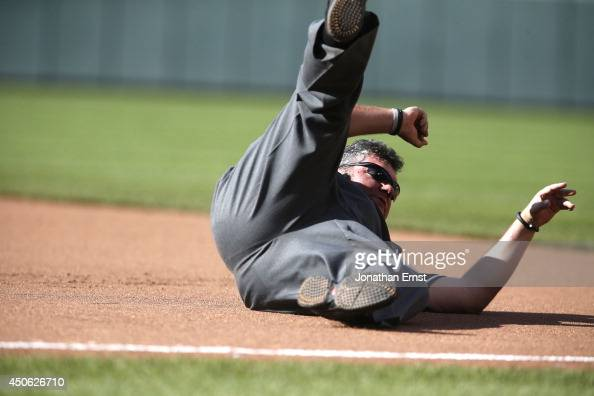 First base umpire Hunter Wendelstedt hits the ground after being knocked over by Adam Jones of the Baltimore Orioles as Jones rounded first on a...