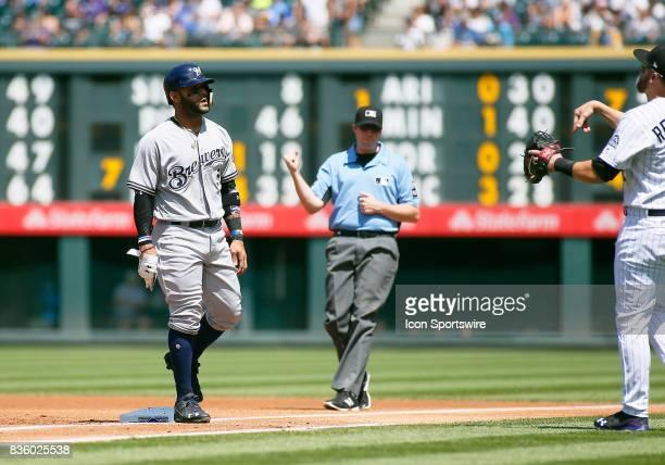 First base umpire Nic Lentz calls out Milwaukee Brewers Infielder Jonathan Villar as he gets doubled up on an infield line drive during a regular...