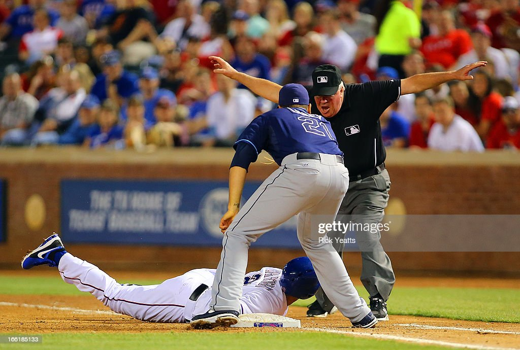 First base umpire <a gi-track='captionPersonalityLinkClicked' href=/galleries/search?phrase=Tim+Welke&family=editorial&specificpeople=224714 ng-click='$event.stopPropagation()'>Tim Welke</a> #3 calls Leonys Martin #2 of the Texas Rangers safe on a late tag by <a gi-track='captionPersonalityLinkClicked' href=/galleries/search?phrase=James+Loney&family=editorial&specificpeople=636293 ng-click='$event.stopPropagation()'>James Loney</a> #21 of the Tampa Bay Rays at Rangers Ballpark in Arlington on April 9, 2013 in Arlington, Texas.