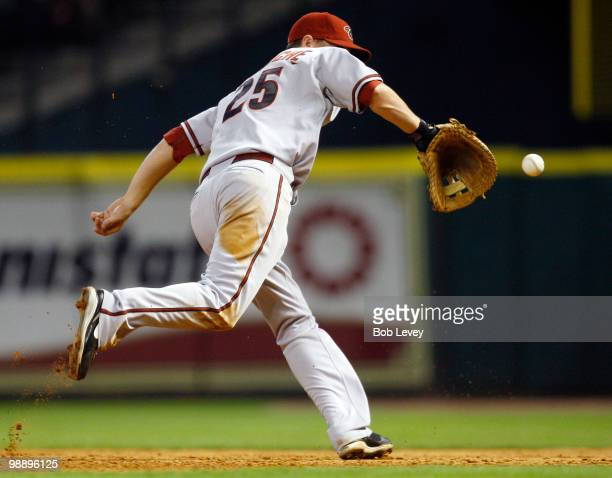 First baseman Adam LaRoche of the Arizona Diamondbacks makes a backhand play on a ball hit by Michael Bourn of the Houston Astros at Minute Maid Park...