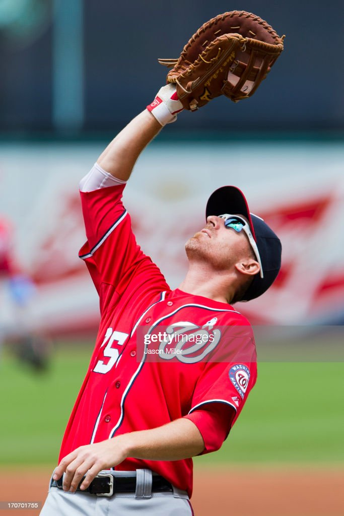 First baseman <a gi-track='captionPersonalityLinkClicked' href=/galleries/search?phrase=Adam+LaRoche&family=editorial&specificpeople=216533 ng-click='$event.stopPropagation()'>Adam LaRoche</a> #25 of the Washington Nationals catches a pop fly hit by Carlos Santana #41 of the Cleveland Indians to end the first inning at Progressive Field on June 16, 2013 in Cleveland, Ohio.