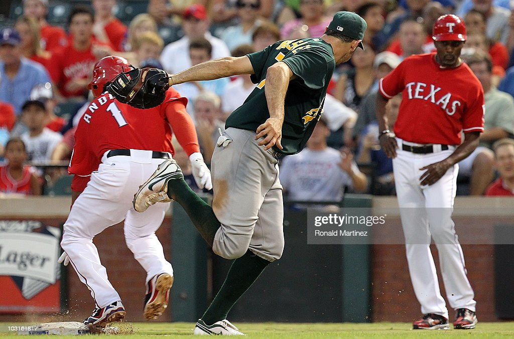 First baseman Adam Rosales #7 of the Oakland Athletics makes an out against Elvis Andrus #1 of the Texas Rangers on July 29, 2010 at Rangers Ballpark in Arlington, Texas.