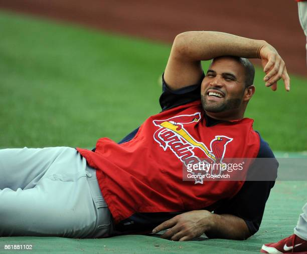 First baseman Albert Pujols of the St Louis Cardinals smiles as he looks on from the field during pregame warm up before a game against the...
