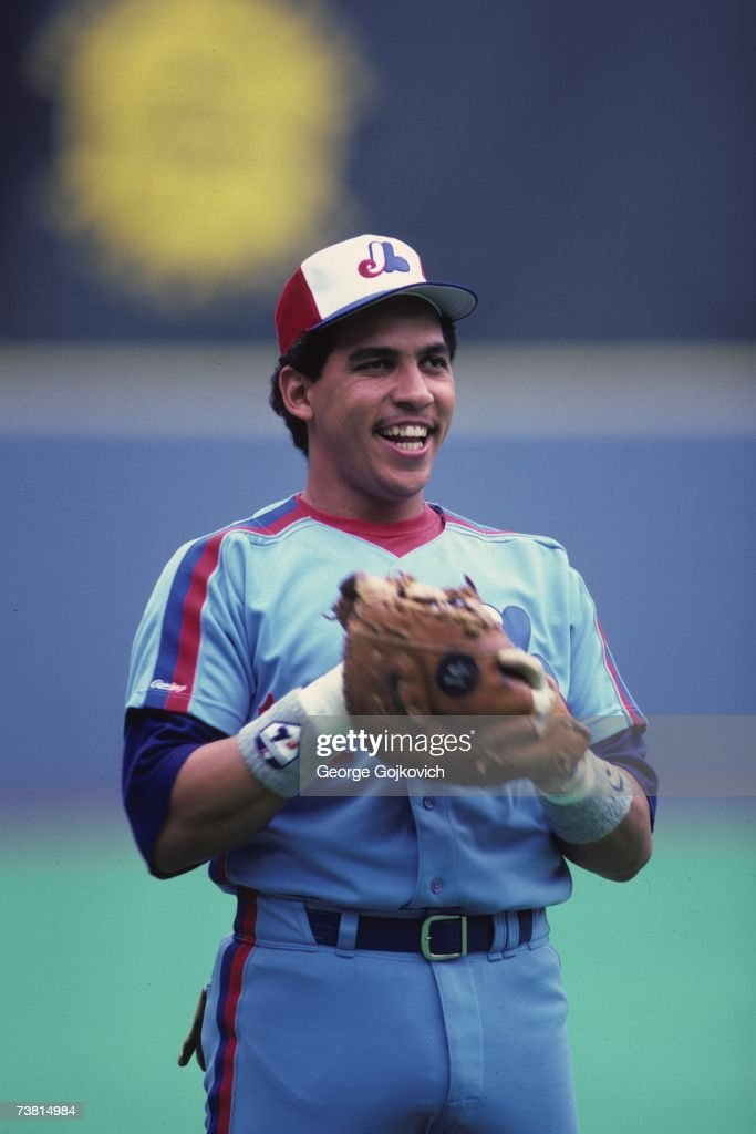 First baseman Andres Galarraga of the Montreal Expos smiles while on the field before the start of a game against the Pittsburgh Pirates at Three...