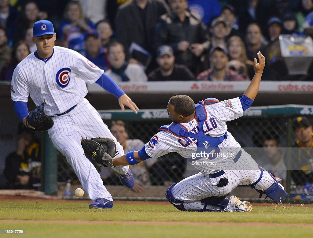 First baseman Anthony Rizzo #44 (L) and catcher Welington Castillo #5 of the Chicago Cubs go for a pop foul hit by Russell Martin #55 of the Pittsburgh Pirates during the second inning at Wrigley Field on April 9, 2014 in Chicago, Illinois.