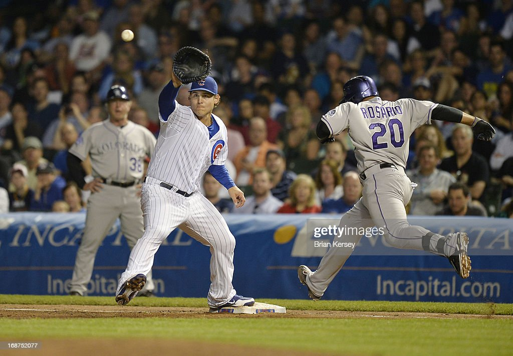 First baseman <a gi-track='captionPersonalityLinkClicked' href=/galleries/search?phrase=Anthony+Rizzo&family=editorial&specificpeople=7551494 ng-click='$event.stopPropagation()'>Anthony Rizzo</a> #44 of the Chicago Cubs catches the ball to retire <a gi-track='captionPersonalityLinkClicked' href=/galleries/search?phrase=Wilin+Rosario&family=editorial&specificpeople=5734314 ng-click='$event.stopPropagation()'>Wilin Rosario</a> #20 of the Colorado Rockies at first base after Rosario hit a ground ball during the fifth inning on May 14, 2013 at Wrigley Field in Chicago, Illinois.