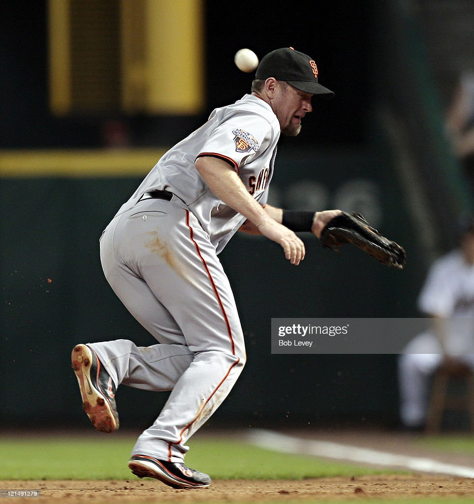 First baseman <a gi-track='captionPersonalityLinkClicked' href=/galleries/search?phrase=Aubrey+Huff&family=editorial&specificpeople=208964 ng-click='$event.stopPropagation()'>Aubrey Huff</a> #17 of the San Francisco Giants misplays a hard hit ball down the line by Wandy Rodriguez of the Houston Astros in the sixth inning scoring two runs> at Minute Maid Park on August 19, 2011 in Houston, Texas.