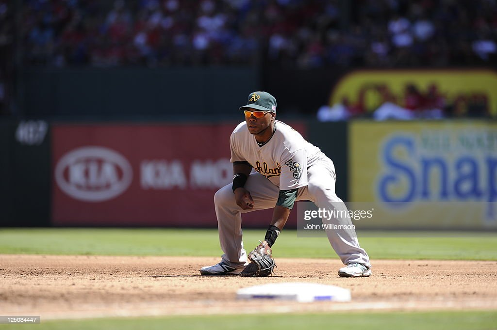 First baseman <a gi-track='captionPersonalityLinkClicked' href=/galleries/search?phrase=Brandon+Allen+-+Baseball+Player&family=editorial&specificpeople=2238262 ng-click='$event.stopPropagation()'>Brandon Allen</a> #31 of the Oakland Athletics looks to home plate for the pitch from his position in the field during the game against the Texas Rangers at Rangers Ballpark on September 11, 2011 in Arlington, Texas. The Texas Rangers defeated the Oakland Athletics 8-1.
