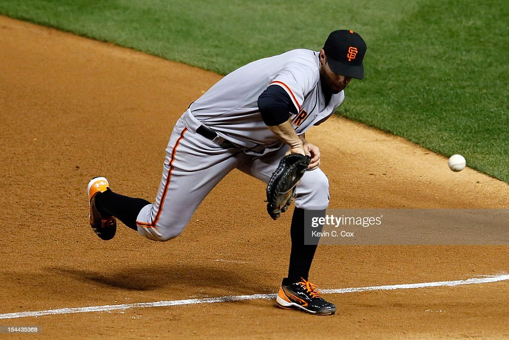 First baseman <a gi-track='captionPersonalityLinkClicked' href=/galleries/search?phrase=Brandon+Belt&family=editorial&specificpeople=7513394 ng-click='$event.stopPropagation()'>Brandon Belt</a> #9 of the San Francisco Giants is unable to field a ball hit by Jon Jay #19 of the St. Louis Cardinals in the eighth inning in Game Five of the National League Championship Series at Busch Stadium on October 19, 2012 in St Louis, Missouri.