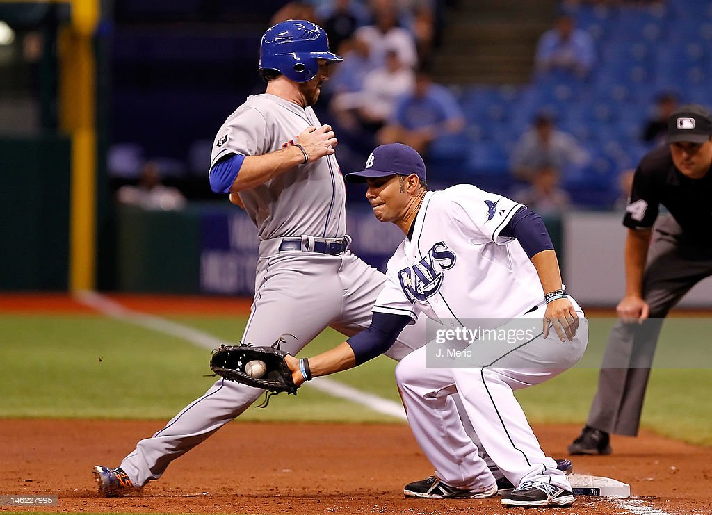 First baseman Carlos Pena #23 of the Tampa Bay Rays takes the throw at first as infielder <a gi-track='captionPersonalityLinkClicked' href=/galleries/search?phrase=Ike+Davis&family=editorial&specificpeople=2349664 ng-click='$event.stopPropagation()'>Ike Davis</a> #29 of the New York Mets gets back safely during the game at Tropicana Field on June 12, 2012 in St. Petersburg, Florida.