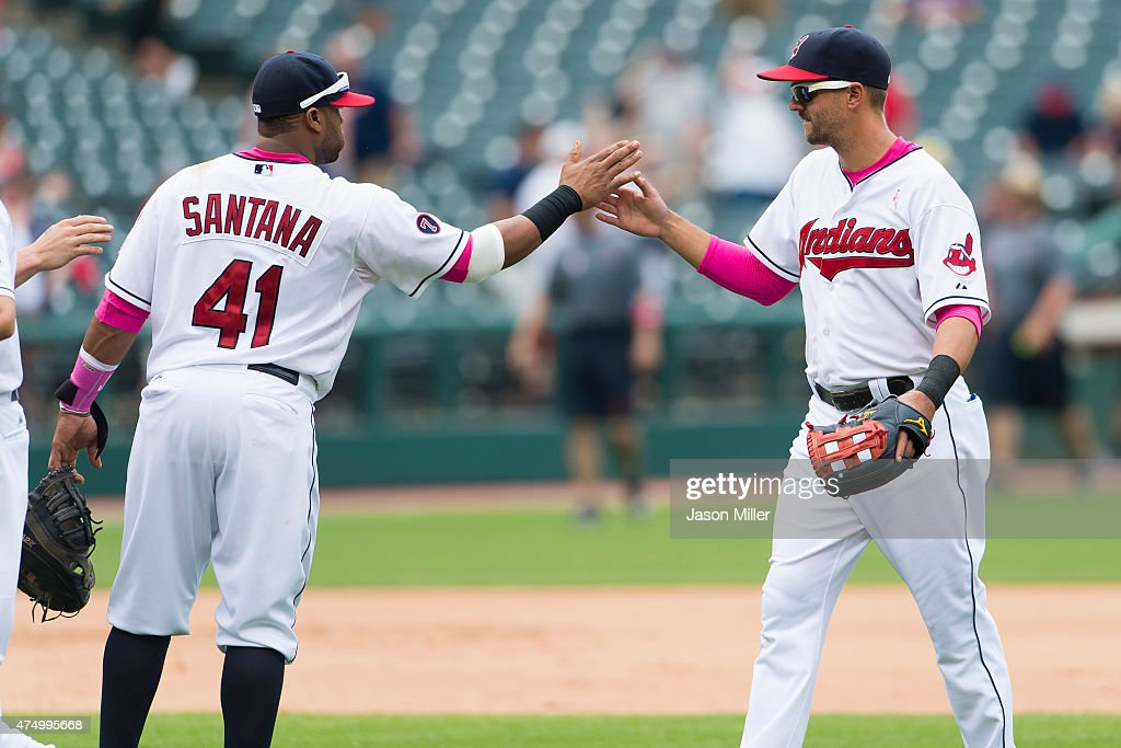 First baseman <a gi-track='captionPersonalityLinkClicked' href=/galleries/search?phrase=Carlos+Santana+-+Baseball+Player&family=editorial&specificpeople=11497843 ng-click='$event.stopPropagation()'>Carlos Santana</a> #41 of the Cleveland Indians celebrates with third baseman <a gi-track='captionPersonalityLinkClicked' href=/galleries/search?phrase=Lonnie+Chisenhall&family=editorial&specificpeople=6796448 ng-click='$event.stopPropagation()'>Lonnie Chisenhall</a> #8 after winning the game against the Minnesota Twins at Progressive Field on May 10, 2015 in Cleveland, Ohio. The Indians defeated the Twins 8-2.