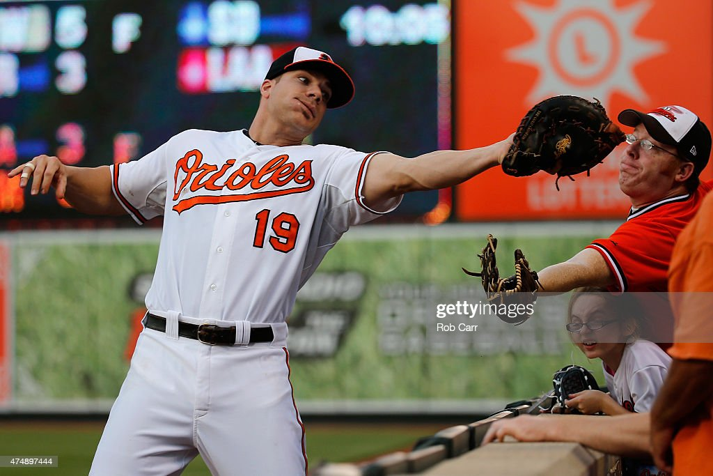 First baseman <a gi-track='captionPersonalityLinkClicked' href=/galleries/search?phrase=Chris+Davis+-+Baseball&family=editorial&specificpeople=7129264 ng-click='$event.stopPropagation()'>Chris Davis</a> #19 of the Baltimore Orioles catches a foul ball hit by Chris Carter #23 of the Houston Astros (not pictured) for the second out of the eighth inning during the Orioles 5-4 win at Oriole Park at Camden Yards on May 27, 2015 in Baltimore, Maryland.