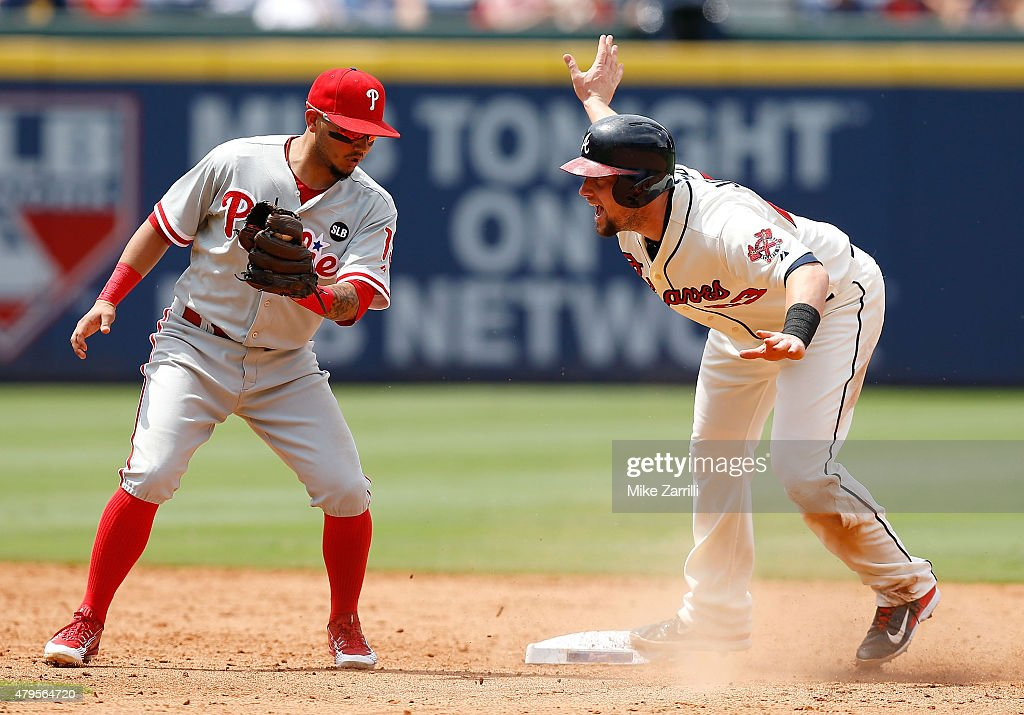 First baseman Chris Johnson of the Atlanta Braves reacts after stealing second base behind the throw to shortstop Freddy Galvis of the Philadelphia...