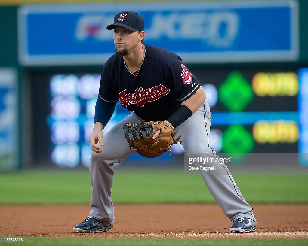 First baseman Chris Johnson of the Cleveland Indians gets set for the pitch in the first inning during a MLB game against the Detroit Tigers at...