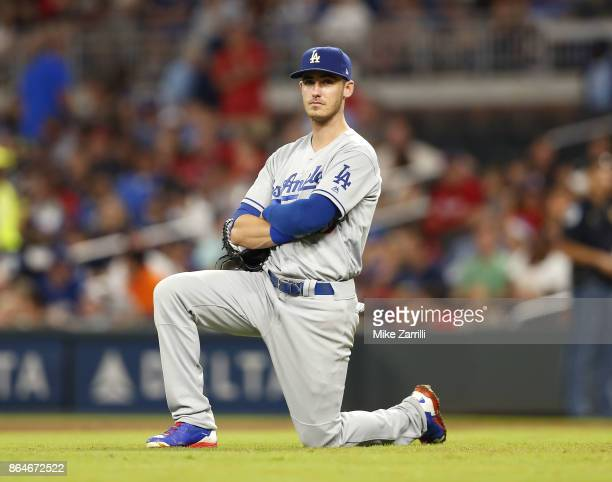 First baseman Cody Bellinger of the Los Angeles Dodgers kneels during a pitching change during the game against the Atlanta Braves at SunTrust Park...