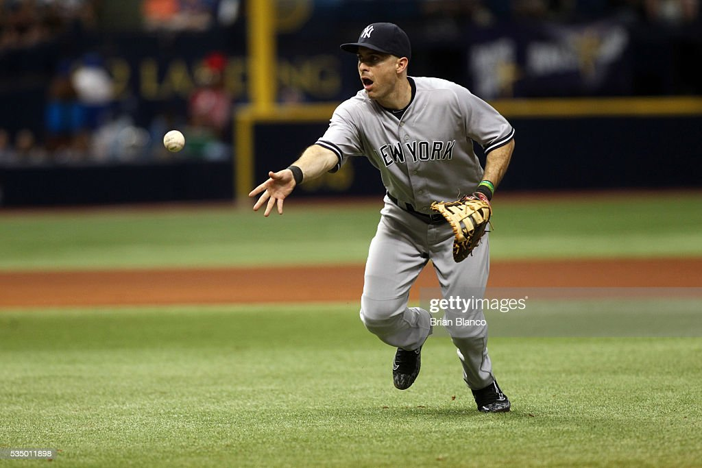 First baseman <a gi-track='captionPersonalityLinkClicked' href=/galleries/search?phrase=Dustin+Ackley&family=editorial&specificpeople=4352278 ng-click='$event.stopPropagation()'>Dustin Ackley</a> #29 of the New York Yankees fields the ground out by Steve Pearce of the Tampa Bay Rays to end the fourth inning of a game on May 28, 2016 at Tropicana Field in St. Petersburg, Florida.
